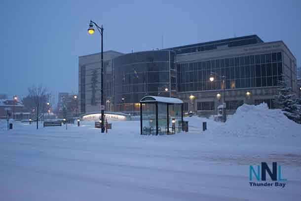 Snow piled up at City hall