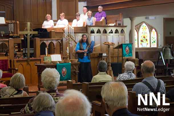 Amanada Perreault addressing First Wesley United Church in Thunder Bay