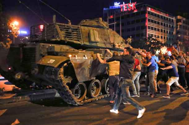 People react near a military vehicle during an attempted coup in Ankara, Turkey. REUTERS/Tumay Berkin