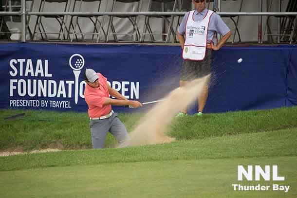 Michael Blair of Ancaster Ontario blasts out of bunker on 18th hole at Whitewater Golf Club