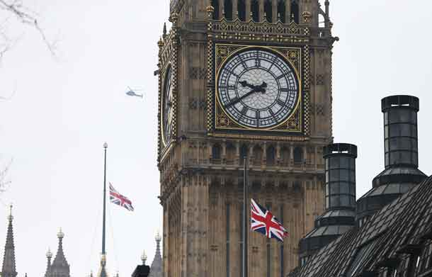 Flags fly at half-mast over the Houses of Parliament. REUTERS/Neil Hall