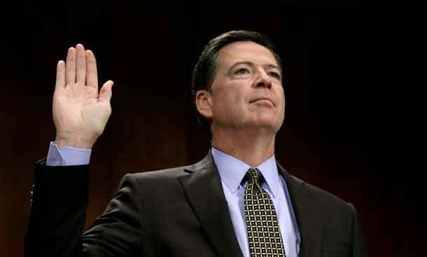 FILE PHOTO: FBI Director James Comey is sworn in to testify before a Senate Judiciary Committee hearing on