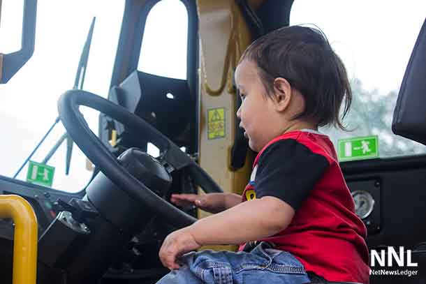 Nation steps up and sits behind the wheel of the Caterpillar Mining Vehicle at 2017 Mining Day in Thunder Bay