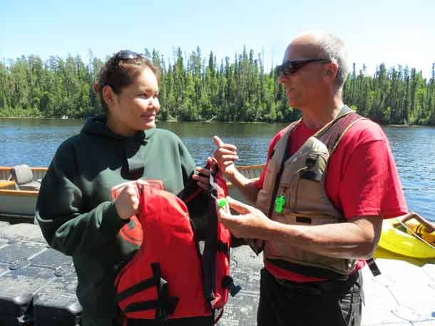Junior Canadian Ranger Laurinda Miles of Fort Severn First Nation receives a life jacket to take home with her from Gordon Giesbrecht. Credit - Sergeant Peter Moon, Canadian Rangers