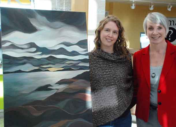 """Artist Colleen Rose with the Honourable Patty Hajdu, who won her painting """"Rossport"""" in an online auction. Minister Hajdu's winning bid of $750 will support breast cancer care in Northwestern Ontario through the Northern Cancer Fund."""