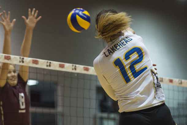 LEAH MOUSSEAU #12 smashes a spike into the opposition's court - photo by Richard Zazulak
