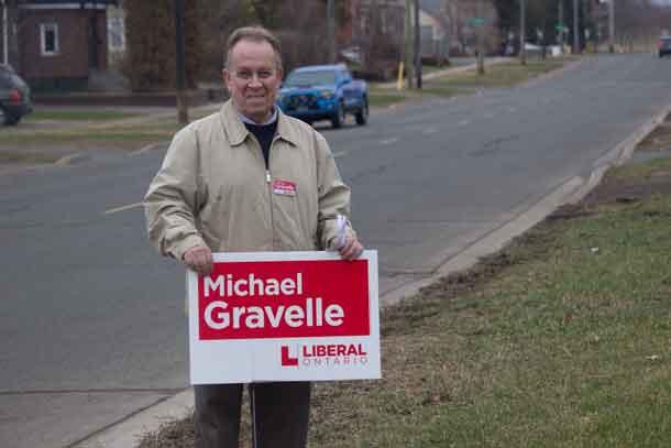Michael Gravelle campaigning on Algoma Street Wednesday night.
