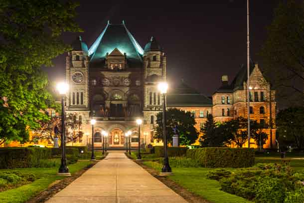 Queen's Park building with beautiful night lighting, the building is the seat of the Provincial Government of Ontario and has a Richardsonian Romnanesque Revival architecture - Image depositphotos.com