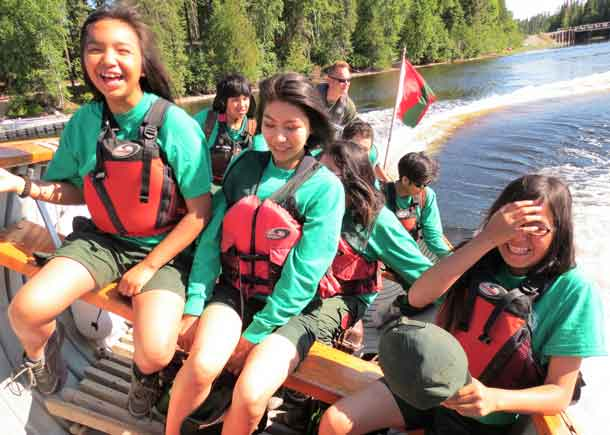 Junior Canadian Rangers react to a sharp turn in boat during water training.