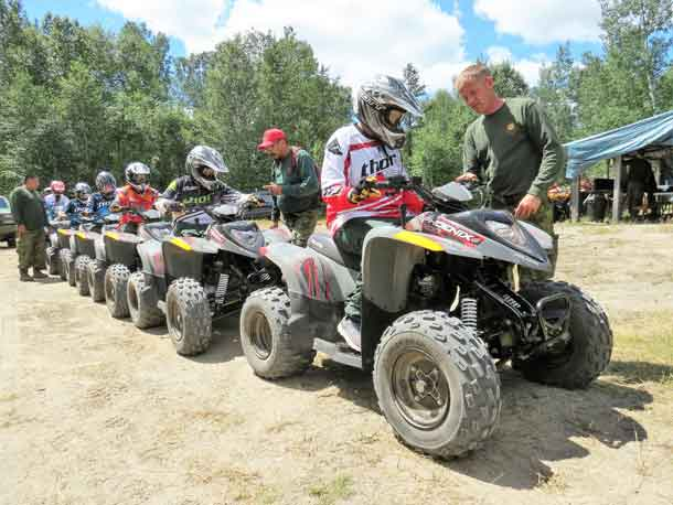 Sergeant Kevin Meikle gives last minute instructions before Junior Canadian Rangers go on a trail ride.