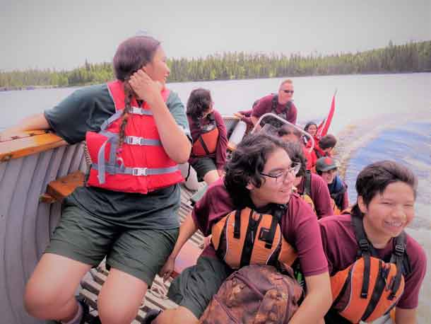 Junior Canadian Rangers react to a fast boat turn.