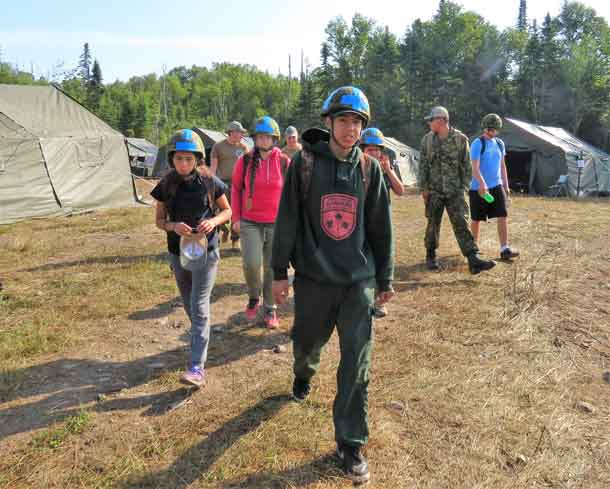 Junior Canadian Ranger Terrance Angeconeb leads his team to a training site.