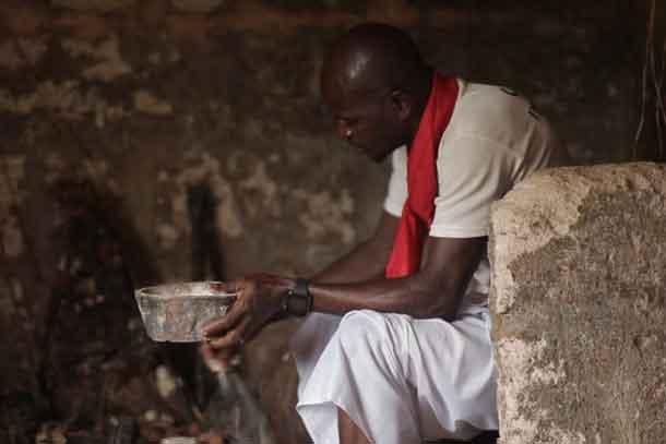 Juju priest David Ubebe performing a ceremony in his shrine, Benin, Nigeria, July 1, 2018. Thomson Reuters Foundation/Kagho Idhebor