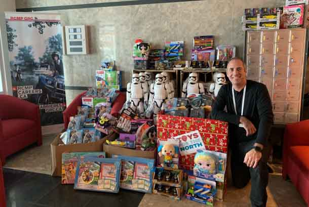 """Corporal Urban Da Ponte provides a """"room full"""" of toys for the annual Toys for the North drive"""