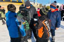Deer Lake Youth reporting for NetNewsLedger on Toys for the North - Message was grins with a forecast for more smiles