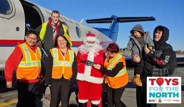 North Star Air Counter Staff and PC12 Captain with Santa and passengers!