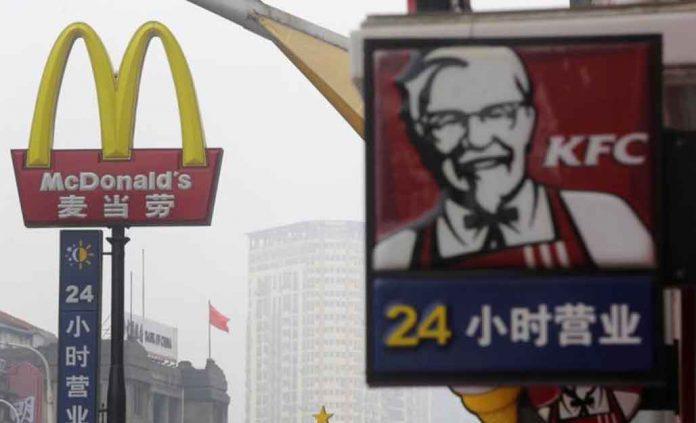 McDonalds and KFC Signs - Images Reuters / Stringer