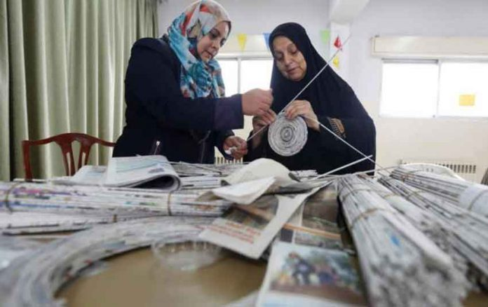 Women recycle newspapers and magazines to create pieces of art and furniture in Amman, Jordan, November 14, 2018. REUTERS/Muhammad Hamed