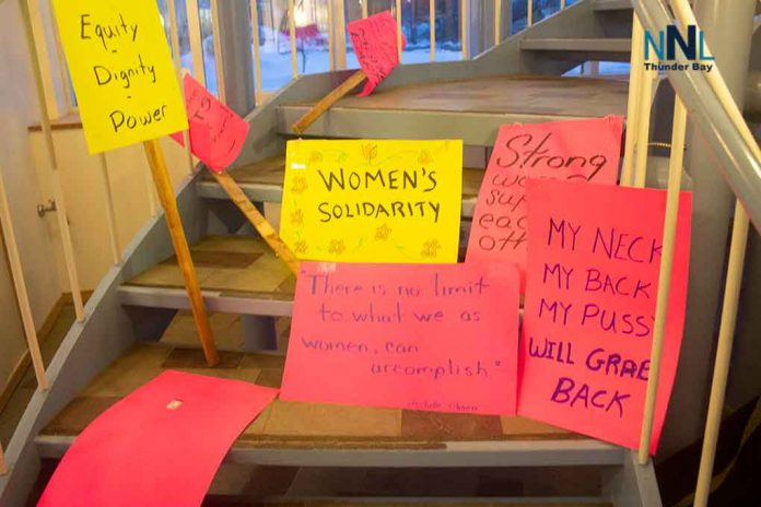 Signs of the times at International Women's Day at OPSEU