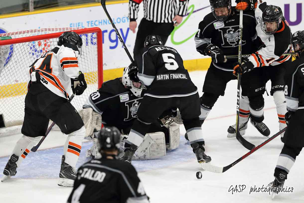 skirmish in front of the crease following an Eric Vanska save off of Magog's Gabriel Fontaine in period 2