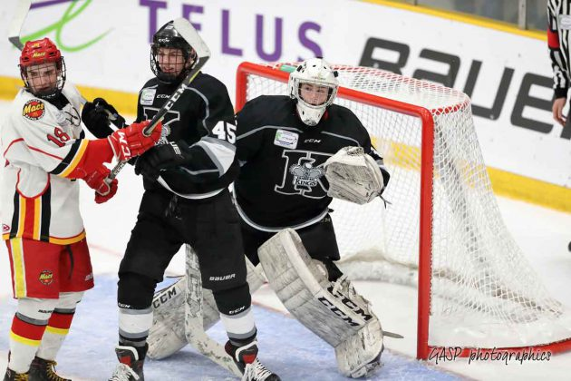 Eric Vanska keeping his eye on the puck from a busy crease