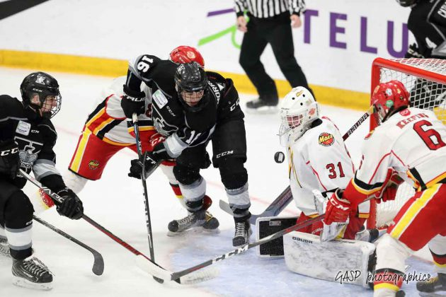 Kings Mackenzie Sedgwick is credited with the game tying goal, as Trenton Morriseau and others watch the puck pass over the shoulder of Jacob Goobie and into the Macs net at 12:42 of the 2nd period.