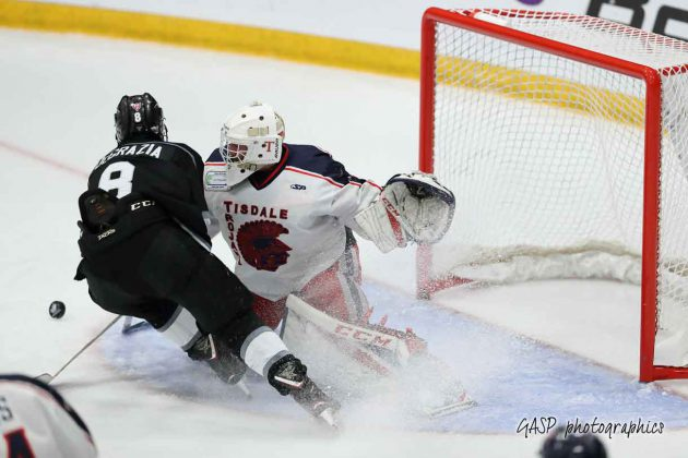 Degrazia gets in the paint with Tanner Martin but can't get it past the Tisdale netminder