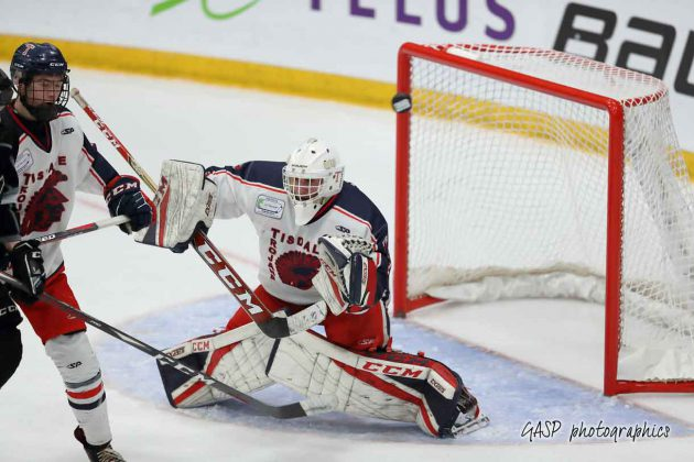 screen shot gets deflected over the net behind Tanner Martin