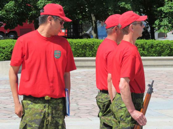 Corporal Angus Sutherland inspects the uniforms of two guard