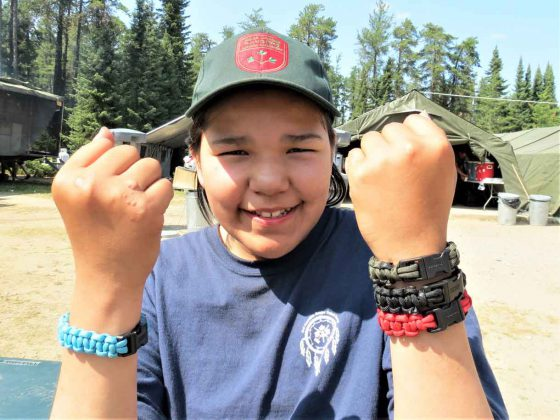 Junior Canadian Ranger Keiannna Scott, 12, of Fort Albany, shows off the bracelets she made at Camp Loon. credit Sergeant Peter Moon, Canadian Rangers