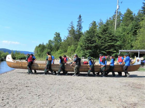 Junior Canadian Rangers carry a voyageur canoe into Lake Superior at Wawa to begin a five-day trip.