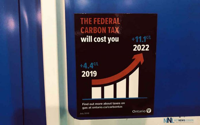 Ontario has mandated that these stickers are on all gas pumps in Ontario explaining the Carbon Tax