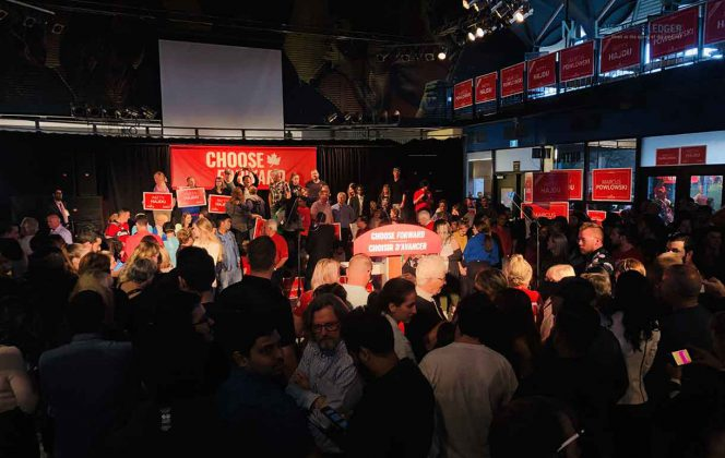 Liberal Supporters await the start of the campaign rally