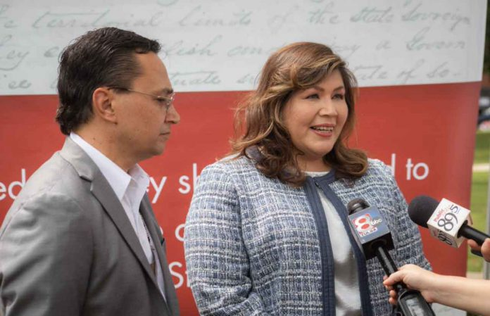 Cherokee Nation Principal Chief Chuck Hoskin Jr., left, and proposed congressional delegate Kimberly Teehee speak August 22 in Tahlequah, Oklahoma, USA. Handout photo by Cherokee Nation Communications