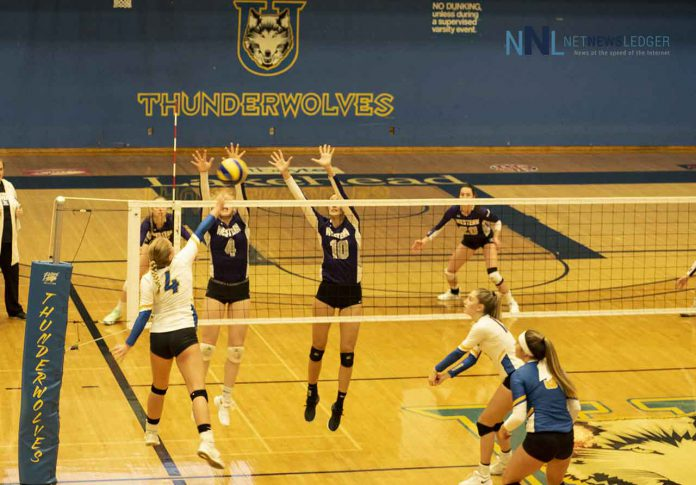 Lakehead Thunderwolf Megan Nahachewsky spikes the ball into the Western Mustangs Defence