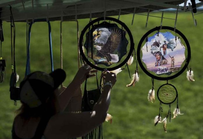 ARCHIVE PHOTO: A woman organizes indigenous items after a Sunrise Ceremony during a