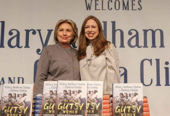 Hillary Clinton and Chelsea Clinton pose for pictures during an event for their new book