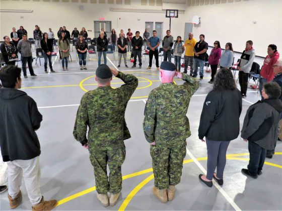 New Canadian Rangers form a circle during the swearing-in ceremony for the new patrol in Long Lake # 58 First Nation