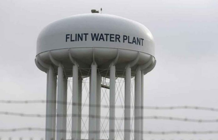 ARCHIVE PHOTO: The Flint Water Plant tower is seen in Flint, Michigan, U.S. on February 7, 2016. REUTERS/Rebecca Cook/File Photo