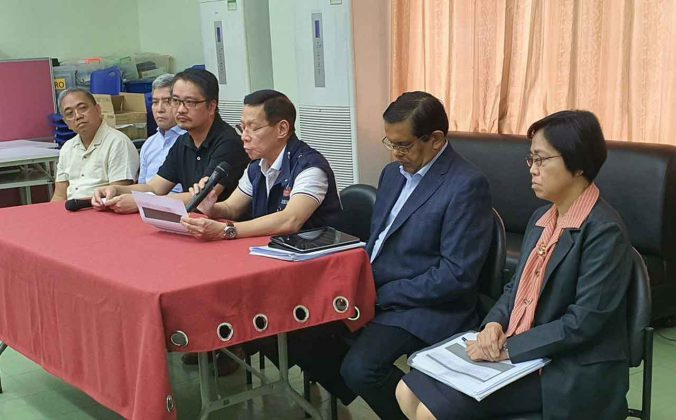 World Health Organization officials brief media at press conference in the Phillipines