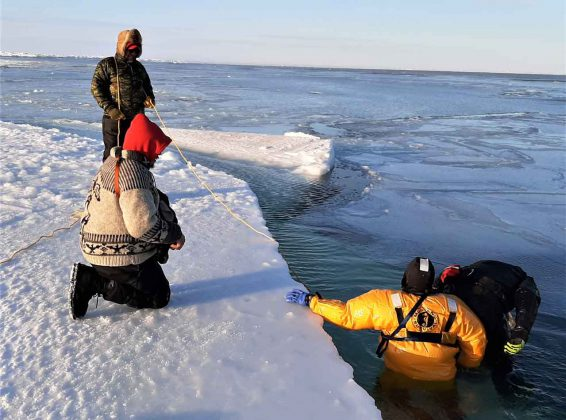 Canadian Rangers practice ice water rescue in an open water section of James Bay. credit Lieutenant-Colonel Shane McArthur, Canadian Rangers