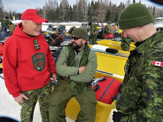 Ranger Gaetan Goulet, left, talks with two soldiers before heading for Beardmore on a snowmobile patrol.
