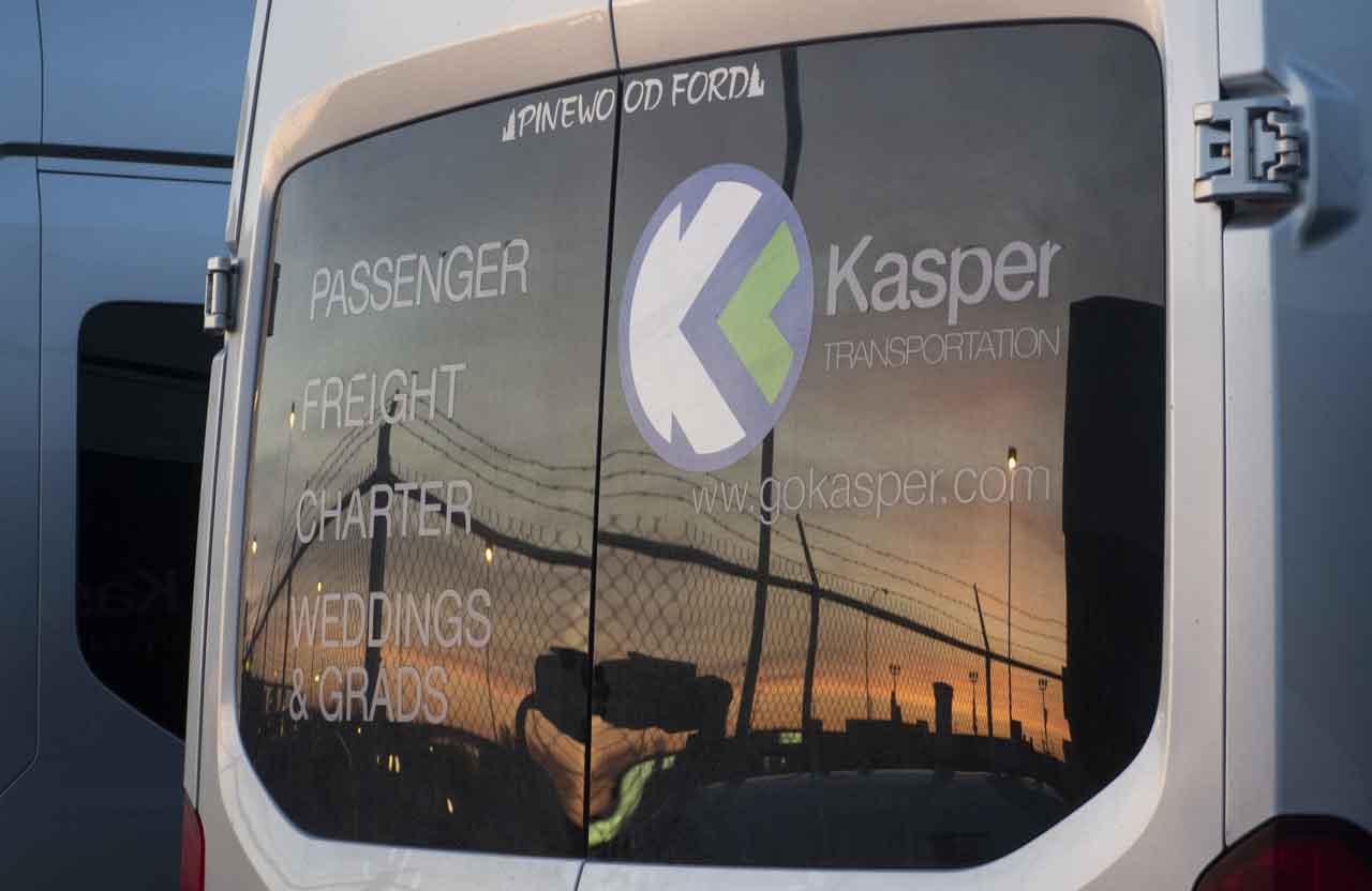 Kasper Transportation bus with sunset in back window