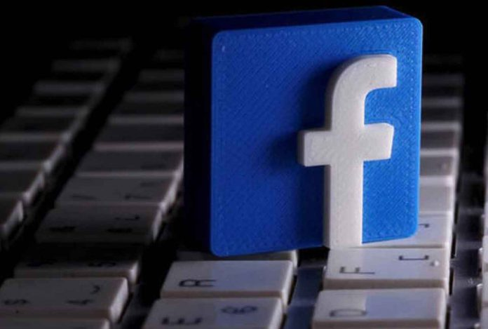 FILE PHOTO: A 3D-printed Facebook logo is seen placed on a keyboard in this illustration taken March 25, 2020. REUTERS/Dado Ruvic/Illustration/File Photo
