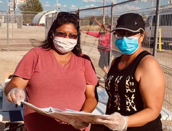 Master Corporal Karen Meeseetawageesic, left, works with Wanda Sugarhead, an Eabametoong band councillor, in preparing lists of the sick and vulnerable to who need to be evacuated on a priority basis to escape the forest fire. -Credit Canadian Rangers