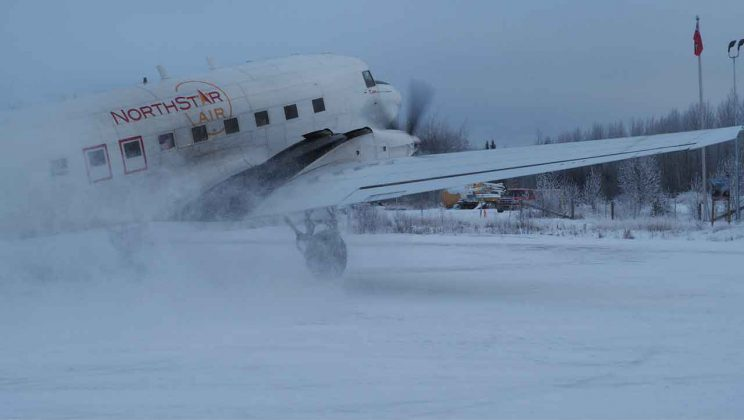 The light dusting of snow gets airborne in Pikangikum as the North Star Air Basler BT-67 lands.