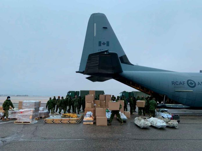Soldiers from CFB Shilo in Manitoba load supplies onto a plane destined for Shamattawa First Nation on Dec. 12.