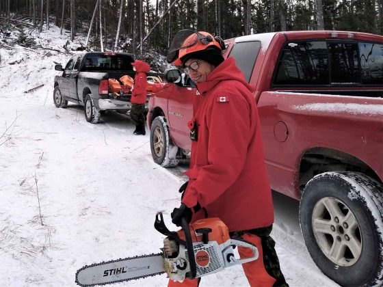 Ranger Clayton Peters prepares to cut wood for the few residents left in Neskantaga and for contractor employees in the First Nation. credit PO2 Kevin McCue