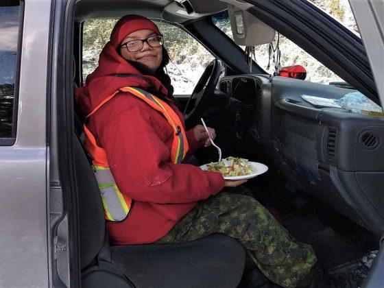 Ranger Nadine Strang eats lunch between duty tasks in Neskantaga. credit - PO2 Kevin McCue