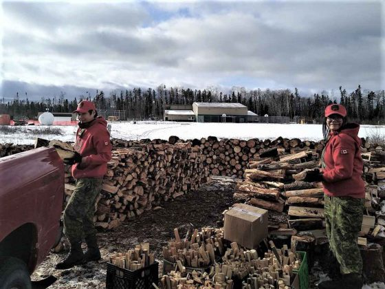 Cpl Eli Owen and Ranger Nadine Strang loading wood - photo credit PO2 Kevin McCue